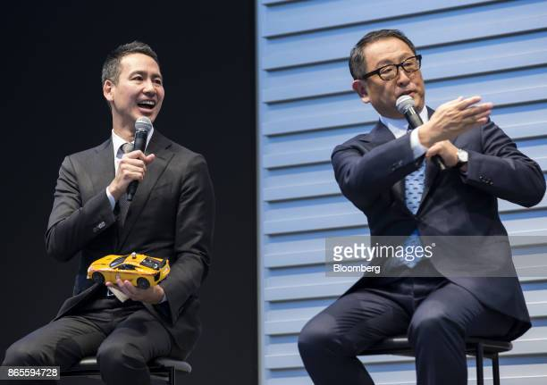 Ichiro Kawanabe chairman and chief executive officer of Nihon Kotsu Co left and Akio Toyoda president of Toyota Motor Corp speak at the launch...
