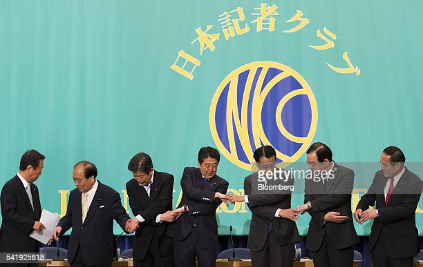 Ichiro Ozawa president of the People's Life Party Taro Yamamoto and Friends from left Toranosuke Katayama coleader of the Initiatives from Osaka...