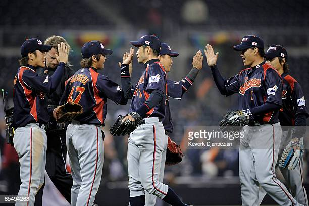 Ichiro Suzuki of Japan is congratulated by teammates after defeating Cuba 50 during the 2009 World Baseball Classic Round 2 Pool 1 Game 5 on March 18...
