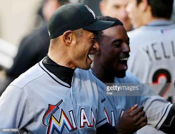 Ichiro Suzuki and Dee Gordon of the Miami Marlins celebrate Giancarlo Stanton's two run homer in the first inning against the New York Mets on April...