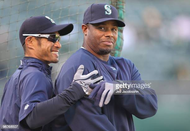 Ichiro Suzuki and Ken Griffey Jr #24 of the Seattle Mariners look on during batting practice against the Oakland Athletics on Opening Day at the...