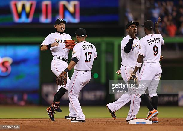 Ichiro Suzuki Donovan Solano Marcell Ozuna and Dee Gordon of the Miami Marlins celebrate after the game against the New York Yankees at Marlins Park...