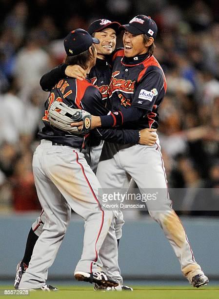 Ichiro Suzuki of Japan celebrates with teammates Norichika Aoki and Seiichi Uchikawa after defeating Korea 5-3 in the finals of the 2009 World...