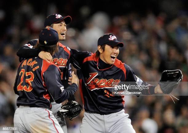 Ichiro Suzuki of Japan celebrates with teammates Norichika Aoki and Seiichi Uchikawa after defeating Korea 53 in the finals of the 2009 World...