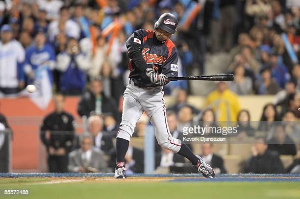 Ichiro Suzuki of Japan hits a single to center to score Seiichi Uchikawa and Akinori Iwamura in the tenth inning of the finals of the 2009 World...