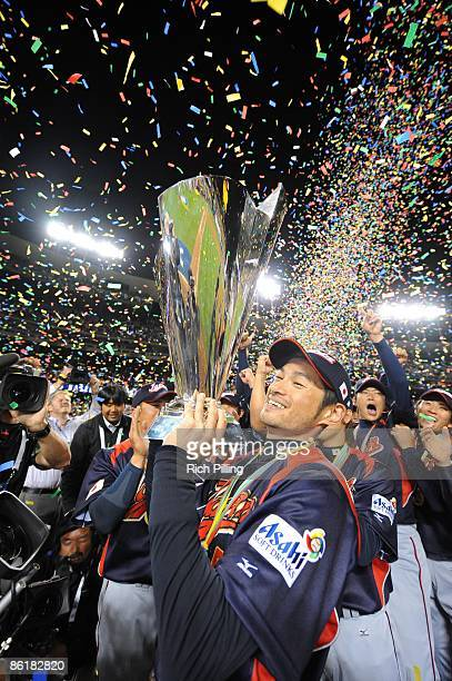 Ichiro Suzuki of Japan holds the trophy after defeating Korea during the World Baseball Classic final game at Dodger Stadium in Los Angeles,...