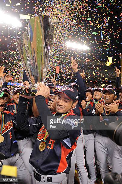 Ichiro Suzuki of Japan holds up the championship trophy after defeating Korea during the finals of the 2009 World Baseball Classic on March 23 2009...