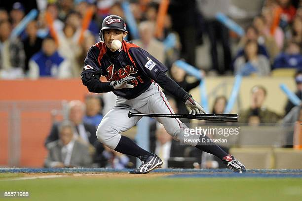 Ichiro Suzuki of Japan lays down a sacrafice bunt in the seventh inning of the finals of the 2009 World Baseball Classic against Korea on March 23...