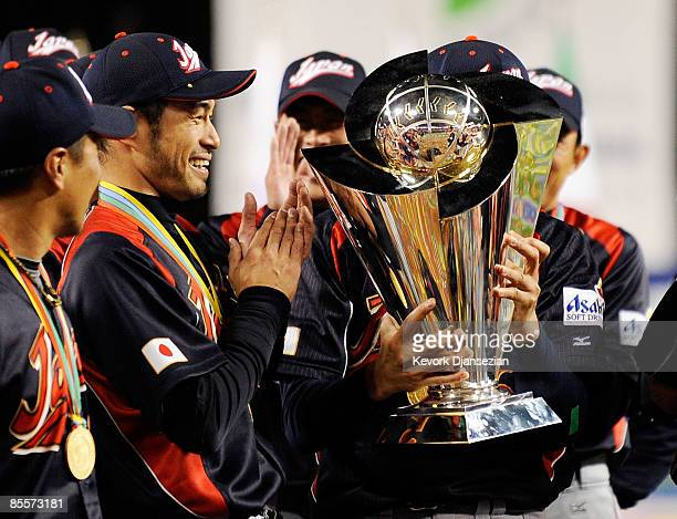 Ichiro Suzuki of Japan looks at the championship trophy after defeating Korea during the finals of the 2009 World Baseball Classic on March 23 2009...