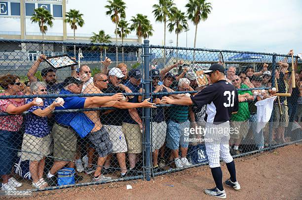 Ichiro Suzuki of New York Yankees signs autographs for the fans during the New York Yankees spring training on February 25 2013 in Tampa Florida