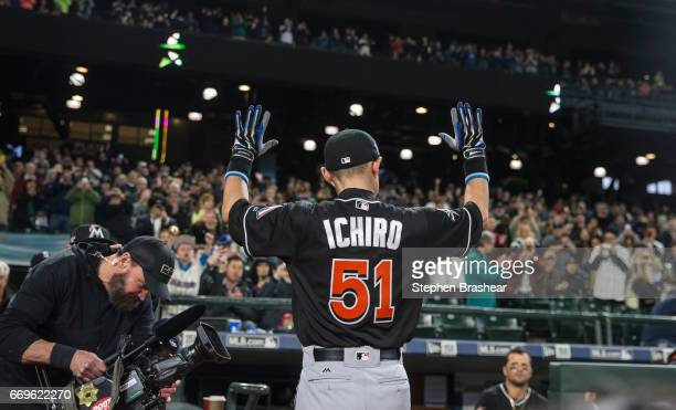 Ichiro Suzuki of the Miami Marlins acknowledges the crowd while being honored by the Seattle Mariners before a game at Safeco Field on April 17 2017...