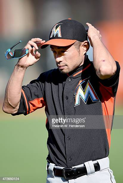 Ichiro Suzuki of the Miami Marlins ajust his cap during batting practice prior to playing the San Francisco Giants at ATT Park on May 8 2015 in San...