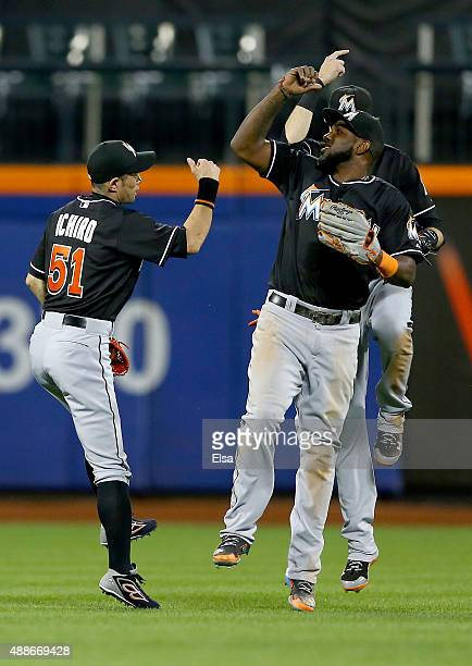 Ichiro Suzuki of the Miami Marlins and teammates Christian Yelich and Marcell Ozuna celebrate the win over the New York Mets on September 16 2015 at...