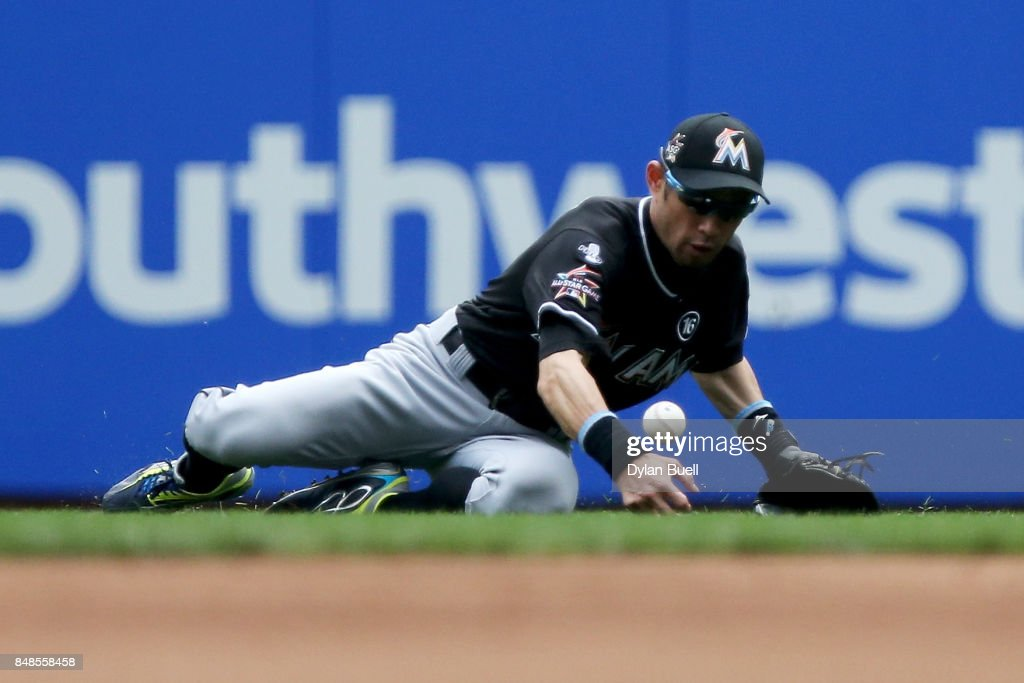 Ichiro Suzuki #51 of the Miami Marlins attempts to field a fly ball in the fourth inning against the Milwaukee Brewers at Miller Park on September 17, 2017 in Milwaukee, Wisconsin.