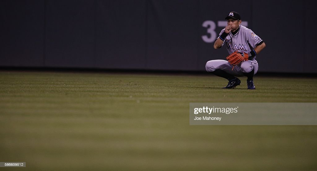 Ichiro Suzuki #51 of the Miami Marlins blows on his hand as he plays right field against the Colorado Rockies in the eighth inning at Coors Field on August 6, 2016 in Denver, Colorado.