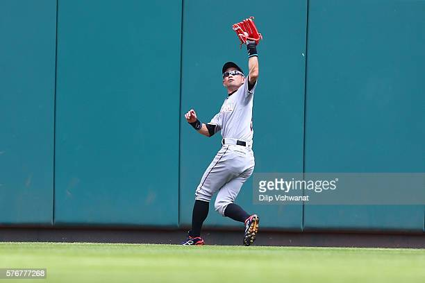Ichiro Suzuki of the Miami Marlins catches a fly ball against the St Louis Cardinals in the second inning at Busch Stadium on July 17 2016 in St...