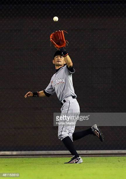 Ichiro Suzuki of the Miami Marlins catches a fly out in the seventh inning during a game against the Philadelphia Phillies at Citizens Bank Park on...
