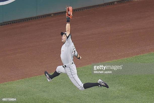 Ichiro Suzuki of the Miami Marlins catches fly ball hit by Wilson Ramos of the Washington Nationals in the third inning during a baseball game at...
