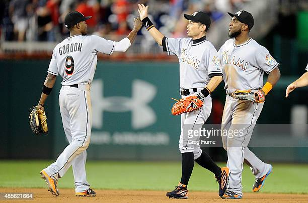 Ichiro Suzuki of the Miami Marlins celebrates with Dee Gordon after a 4-3 victory against the Washington Nationals at Nationals Park on August 28,...