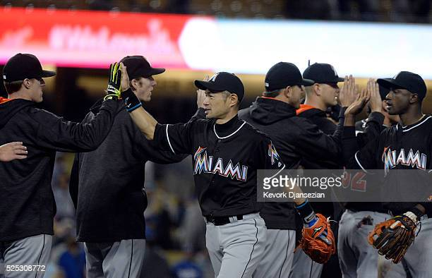 Ichiro Suzuki of the Miami Marlins celebrates with his teammates after shutting out the Los Angeles Dodgers 20 at Dodger Stadium on April 27 2016 in...
