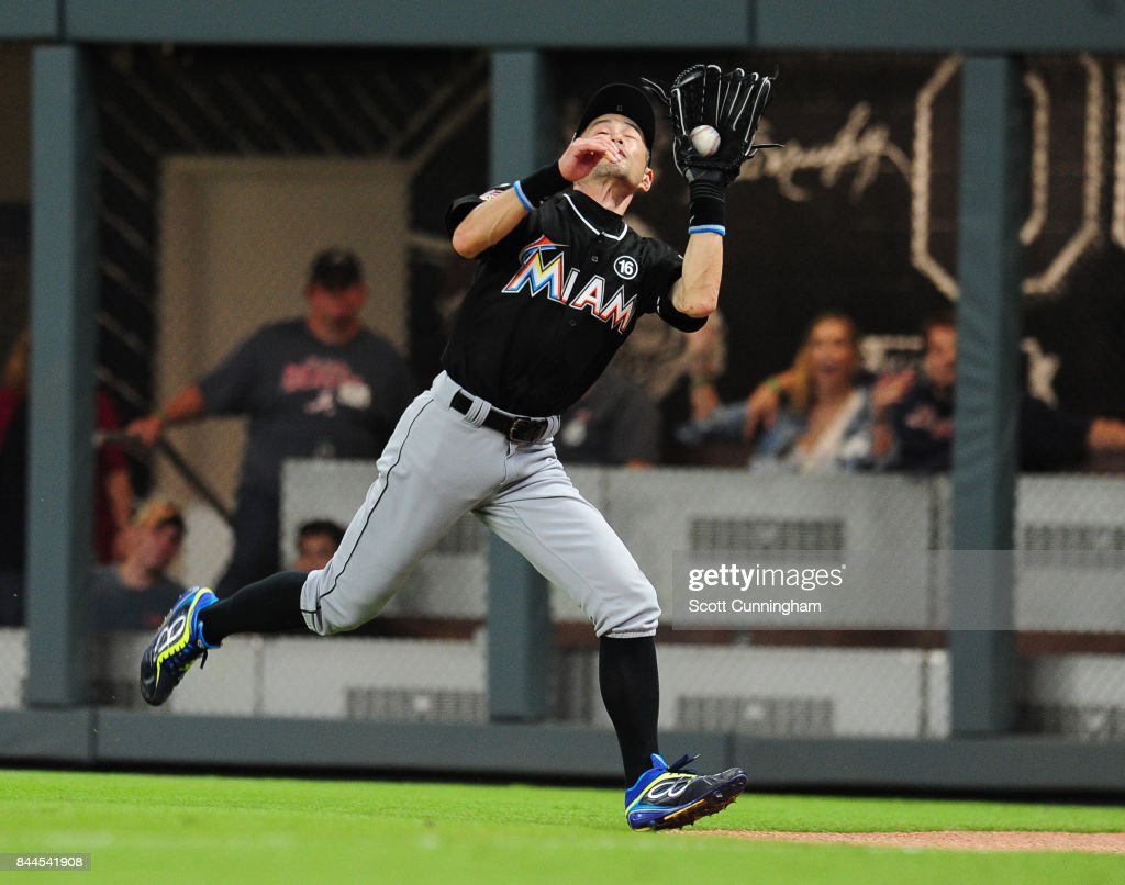 Ichiro Suzuki #51 of the Miami Marlins chases down a fly ball during the sixth inning against the Atlanta Braves at SunTrust Park on September 8, 2017 in Atlanta, Georgia.