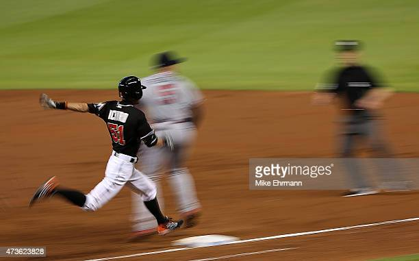 Ichiro Suzuki of the Miami Marlins digs out an infield hit during a game against the Atlanta Braves at Marlins Park on May 16 2015 in Miami Florida