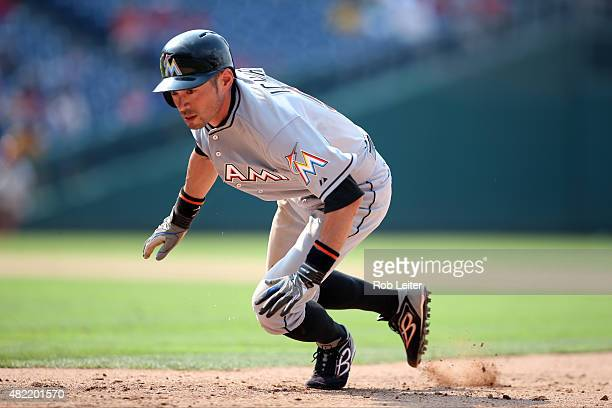 Ichiro Suzuki of the Miami Marlins dives back into first base during the game against the Philadelphia Phillies at Citizens Bank Park on July 19,...