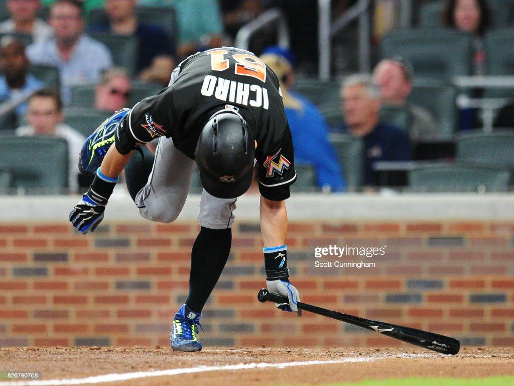 Ichiro Suzuki #51 of the Miami Marlins ducks to avoid an eighth inning pitch against the Atlanta Braves at SunTrust Park on August 5, 2017 in Atlanta, Georgia.