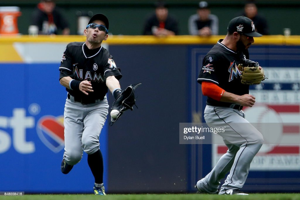 Ichiro Suzuki #51 of the Miami Marlins fails to catch a fly ball in front of Mike Aviles #12 in the fourth inning against the Milwaukee Brewers at Miller Park on September 17, 2017 in Milwaukee, Wisconsin.