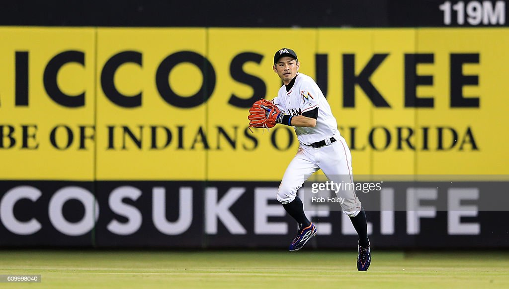 Ichiro Suzuki #51 of the Miami Marlins fields a ball during the ninth inning of the game against the Atlanta Braves at Marlins Park on September 23, 2016 in Miami, Florida.