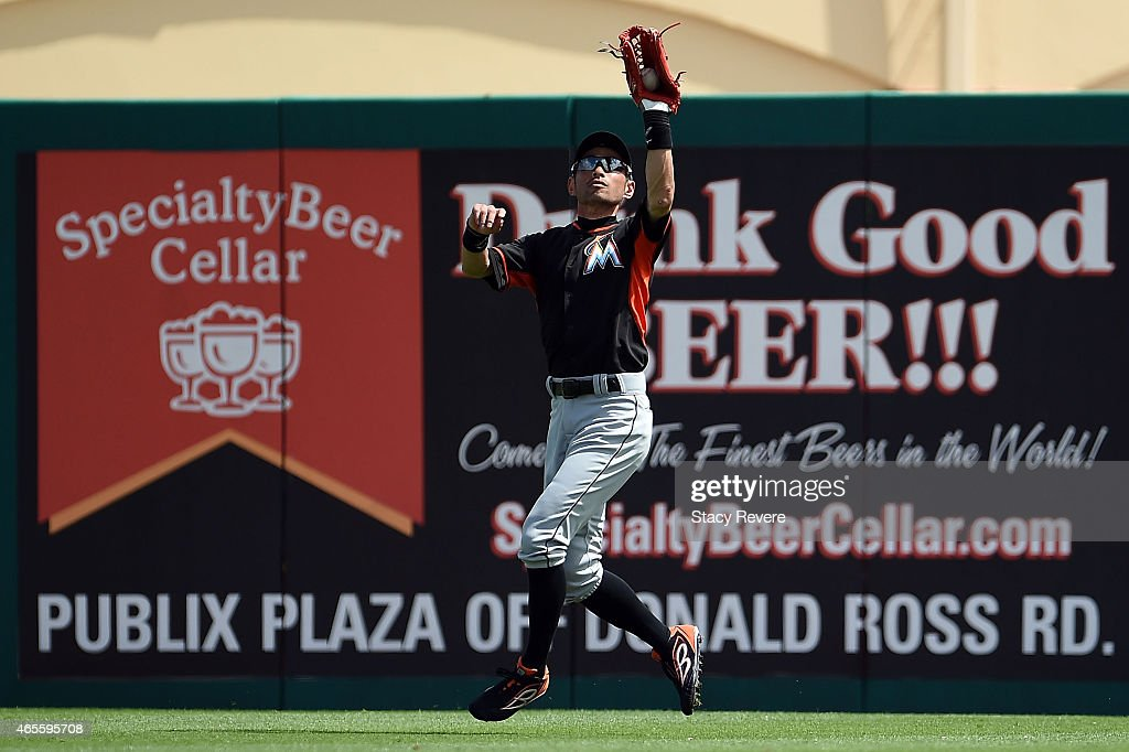 Ichiro Suzuki #51 of the Miami Marlins fields a fly ball during the first inning of a spring training game against the St. Louis Cardinals at Roger Dean Stadium on March 8, 2015 in Jupiter, Florida.