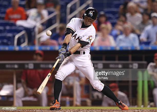 Ichiro Suzuki of the Miami Marlins gets a hit during the fifth inning of the game at Marlins Park on May 18, 2015 in Miami, Florida. This was...