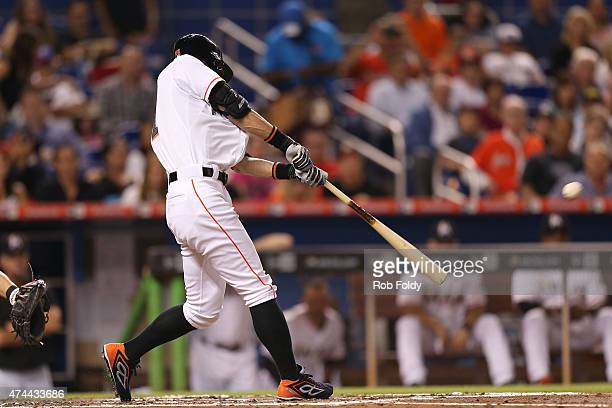 Ichiro Suzuki of the Miami Marlins gets a hit during the second inning of the game against the Baltimore Orioles at Marlins Park on May 22 2015 in...