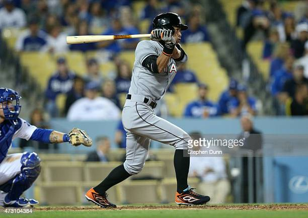 Ichiro Suzuki of the Miami Marlins grounds out for the third out of the top of the seventh inning against the Los Angeles Dodgers at Dodger Stadium...