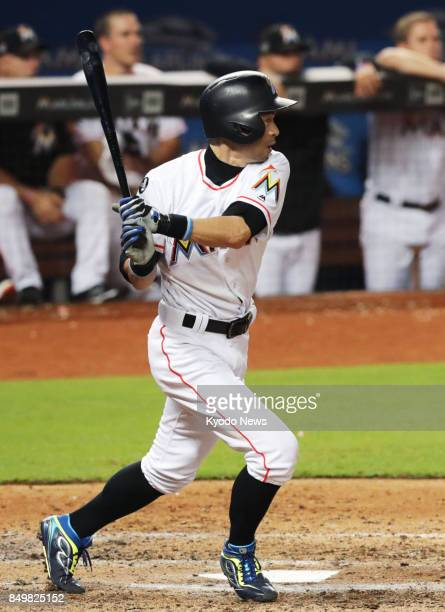 Ichiro Suzuki of the Miami Marlins hits a gametying single in the ninth inning against the New York Mets at Marlins Park on Sept 19 2017 JT Realmuto...