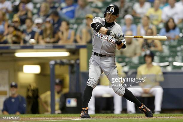 Ichiro Suzuki of the Miami Marlins hits a single during the first inning against the Milwaukee Brewers at Miller Park on August 18 2015 in Milwaukee...