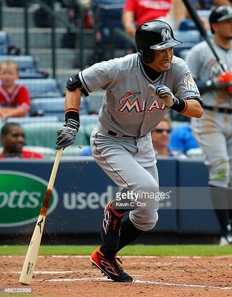 Ichiro Suzuki of the Miami Marlins hits a single in the eighth inning against the Atlanta Braves at Turner Field on September 2, 2015 in Atlanta,...