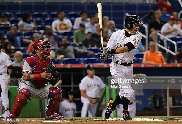 Ichiro Suzuki of the Miami Marlins hits a single in the first inning during a game against the Philadelphia Phillies at Marlins Park on August 20...