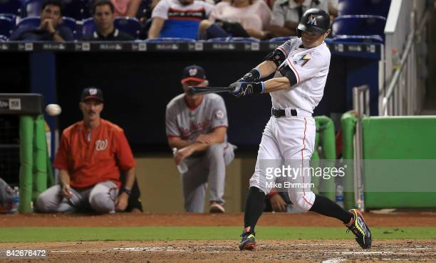 Ichiro Suzuki of the Miami Marlins hits a single in the seventh inning during a game against the Washington Nationals at Marlins Park on September 4...