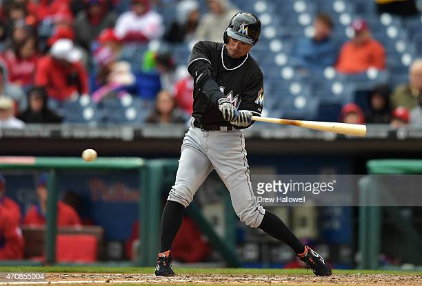 Ichiro Suzuki of the Miami Marlins hits a single in the seventh inning against the Philadelphia Phillies at Citizens Bank Park on April 23 2015 in...