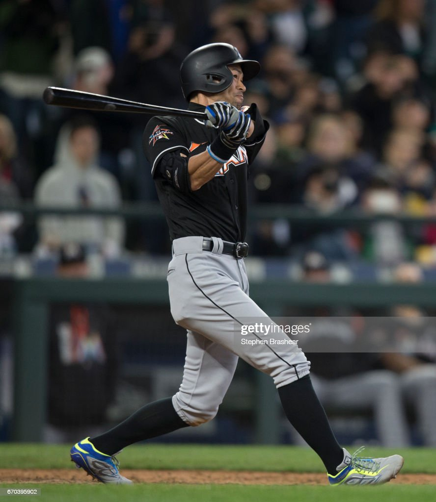 Ichiro Suzuki #51 of the Miami Marlins hits a solo home run off of relief pitcher Evan Marshall of the Seattle Mariners during the ninth inning of a game at Safeco Field on April 19, 2017 in Seattle, Washington. The Mariners 10-5.