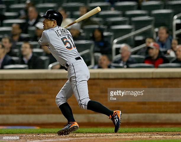 Ichiro Suzuki of the Miami Marlins hits a triple in the seventh inning against the New York Mets on April 16 2015 at Citi Field in the Flushing...