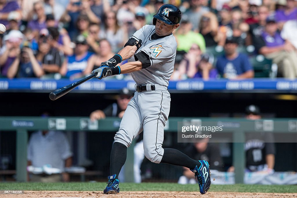 Ichiro Suzuki #51 of the Miami Marlins hits a triple off of Chris Rusin #52 of the Colorado Rockies for the 3,000th hit of his major league career in the seventh inning of a game at Coors Field on August 7, 2016 in Denver, Colorado.