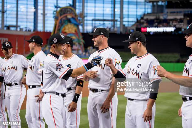 Ichiro Suzuki of the Miami Marlins interacts with Junichi Tazawa before the Opening Day game against the Atlanta Braves at Marlins Park on April 11...