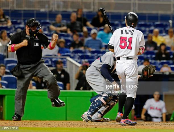 Ichiro Suzuki of the Miami Marlins is called out on strikes by home plate unpire Dan Bellino to end the game against the Miami Marlins at Marlins...