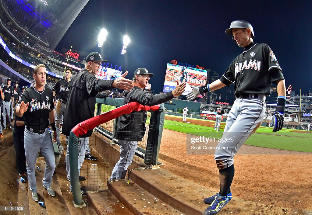 Ichiro Suzuki #51 of the Miami Marlins is congratulated by teammates after scoring a ninth inning run against the Atlanta Braves at SunTrust Park on September 8, 2017 in Atlanta, Georgia.