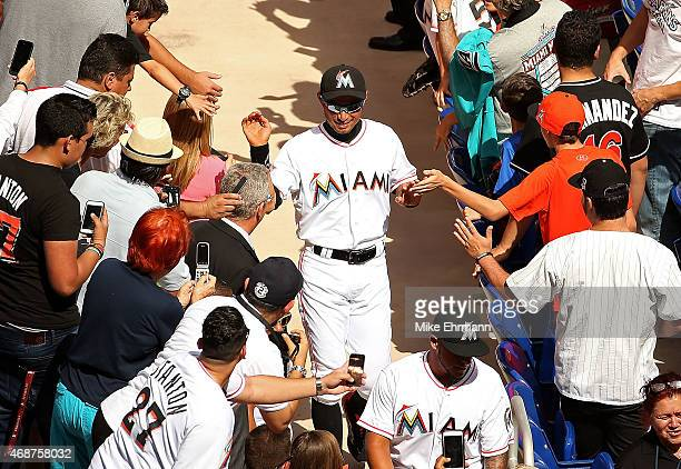 Ichiro Suzuki of the Miami Marlins is greeted during Opening Day against the Atlanta Braves at Marlins Park on April 6 2015 in Miami Florida