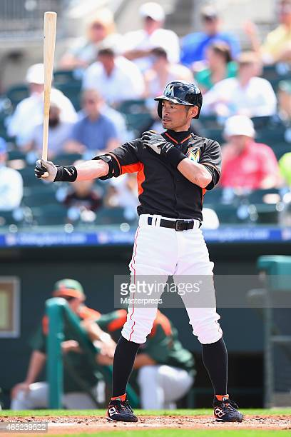 Ichiro Suzuki of the Miami Marlins is seen at bat during the exhibition game against the University of Miami Hurricanes during the spring training at...