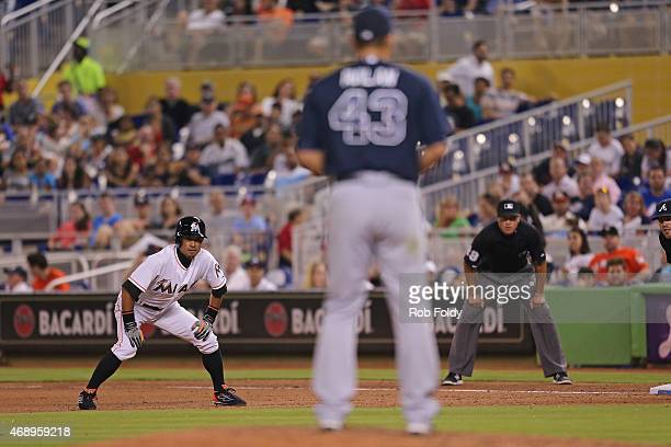Ichiro Suzuki of the Miami Marlins leads off first base during the seventh inning of the game against the Atlanta Braves at Marlins Park on April 8...