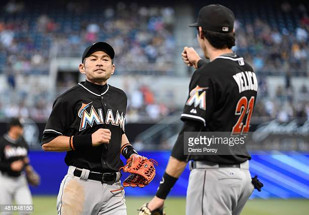 Ichiro Suzuki of the Miami Marlins left is congratulated by Christian Yelich after making a catch on a ball hit by Matt Kemp of the San Diego Padres...